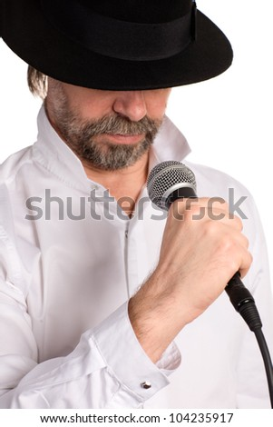 Portrait of a singer with microphone isolated on white. Focus on the microphone.
