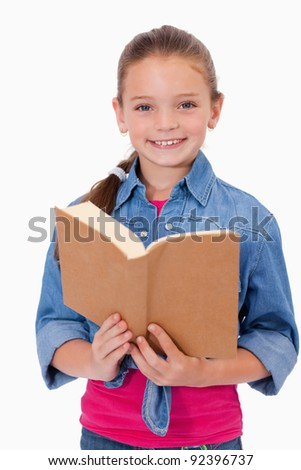 Portrait of a smart girl reading a book against a white background