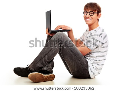 Portrait of a smart young man with a laptop. Isolated over white background.