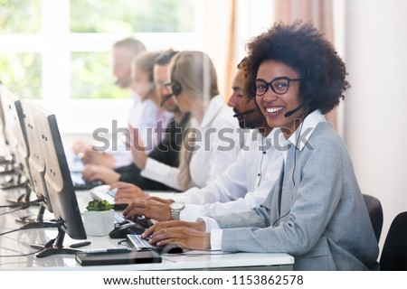 Portrait Of A Smiling African Female Customer Service Executive