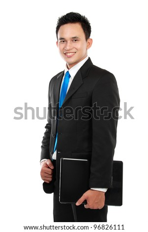 Portrait of a smiling asian business man with a laptop isolated on white background