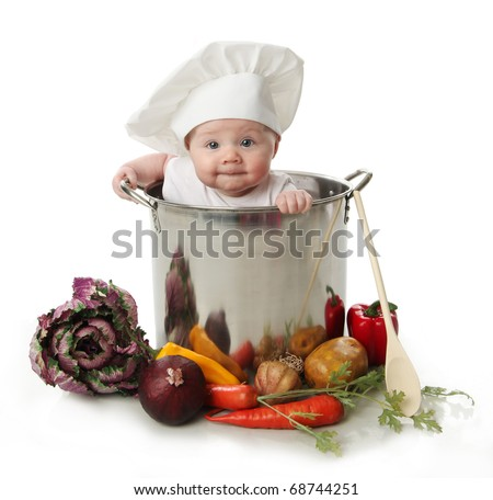 Stock Photo Portrait of a smiling baby sitting wearing a chef hat sitting inside a large cooking stock pot surrounded by vegetables and food, isolated on white