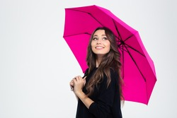 Portrait of a smiling beautiful woman holding umbrella and looking up isolated on a white background