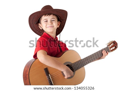 portrait of a smiling boy with acoustic guitar