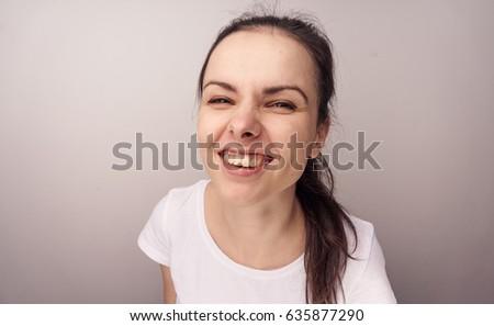 Portrait of a smiling brunette         #635877290