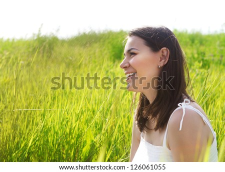 Portrait of a smiling brunette woman in summer day
