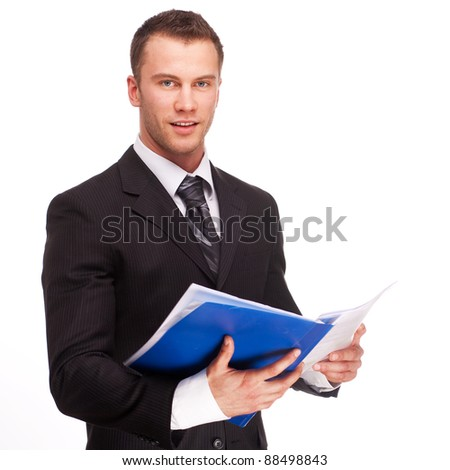 Portrait of a smiling business man with documents isolated on white background. Studio shot.