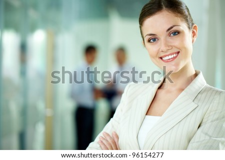 Portrait of a smiling business woman looking confidently at camera