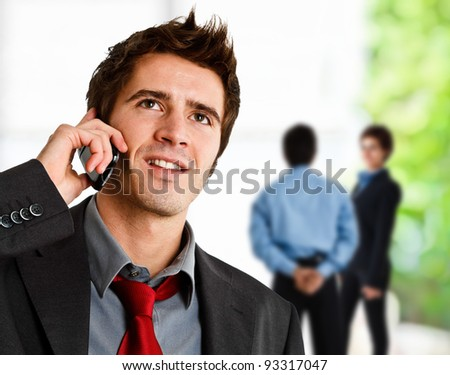 Portrait of a smiling businessman speaking on the phone