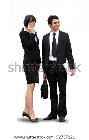 Portrait of a smiling businessman with a suitcase and a businesswoman with a phone