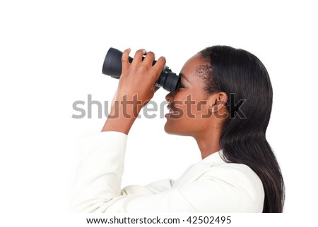 Portrait of a smiling businesswoman using binoculars against a white background