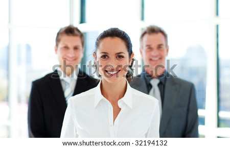 Portrait of a smiling businesswoman with her team - stock photo