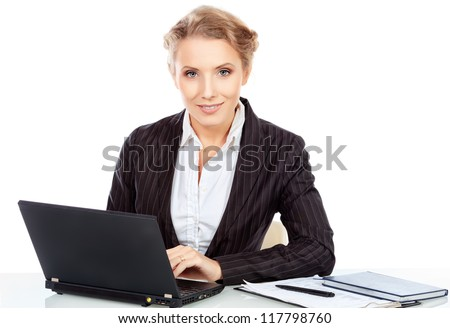Portrait of a smiling businesswoman working on a laptop. Isolated over white.