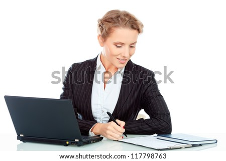 Portrait of a smiling businesswoman working on a laptop. Isolated over white. - stock photo