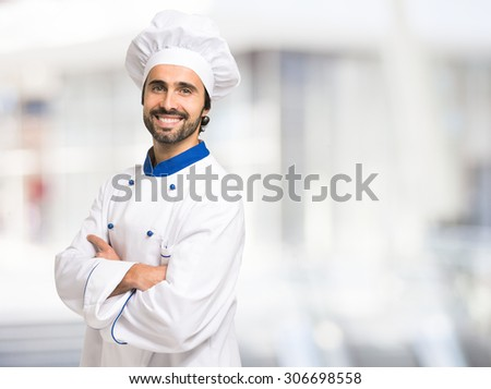 Portrait of a smiling chef in front of a bright background