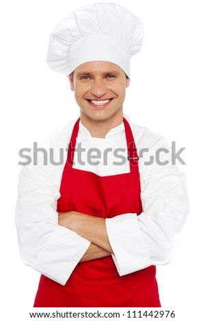 Portrait of a smiling chef with his arms crossed isolated against white background