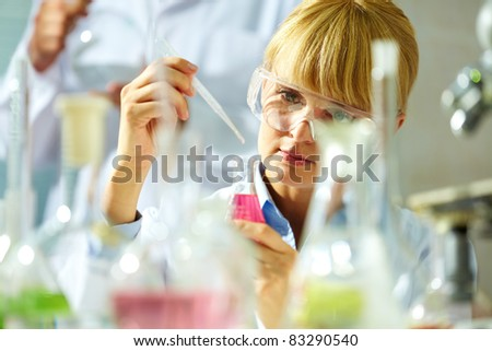 Portrait of a smiling chemist working with medicine
