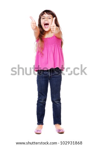 Portrait of a smiling cute little girl gesturing thumbs up sign against white background