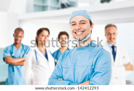 Portrait of a smiling doctor in front of his team