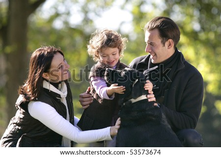 Portrait of a smiling family with a dog