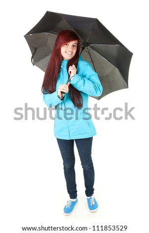 portrait of a smiling female with black umbrella, full length, white background