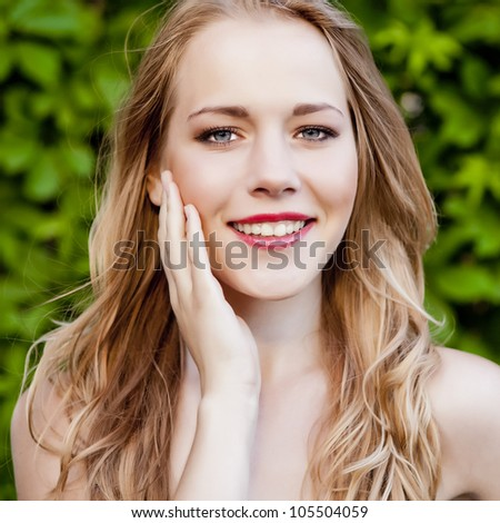portrait of a smiling girl in the park