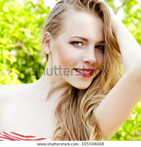 portrait of a smiling girl in the park - stock photo