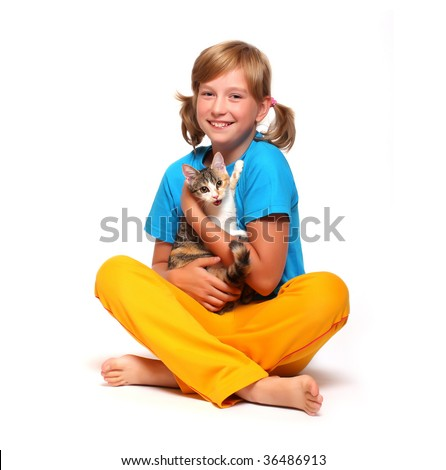 Portrait of a smiling girl with cat.