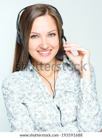 Portrait of a smiling happy woman call center operator .