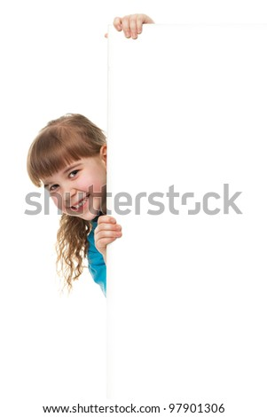 Portrait of a  smiling little girl   standing near huge blank board and holding it. Lots of copyspace for your text and logo. Advertising concept. Isolated on white