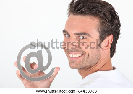 Portrait of a smiling man with at sign