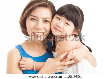 Portrait of a smiling mother embracing her little daughter