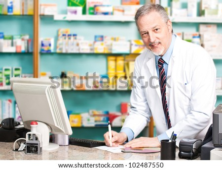 Portrait of a smiling pharmacist in his shop