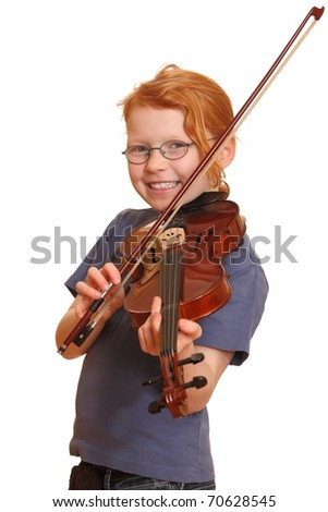 Portrait of a smiling red haired girl with violin