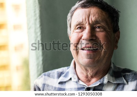 Portrait of a smiling senior man #1293050308
