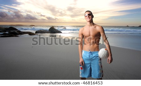 Portrait of a smiling volleyball player standing at the beach