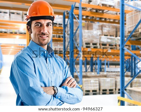 Portrait of a smiling warehouse keeper at work
