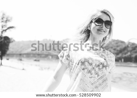 portrait of a smiling woman, happy girl in nature, positive walk on the beach with a sun girl. Film Texture & Unfocused #528509902