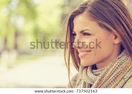 portrait of a smiling woman in...