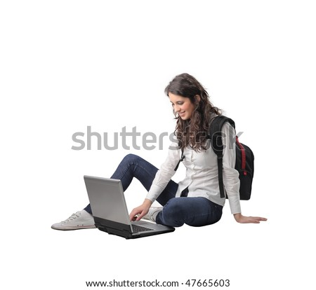 Portrait of a smiling woman sitting and using a laptop