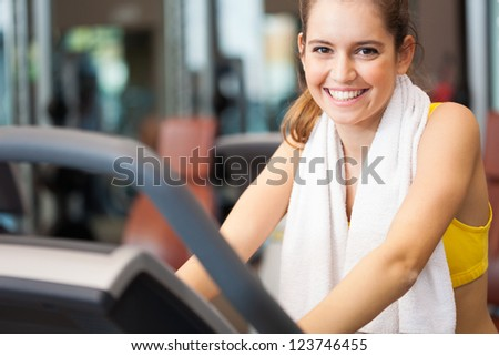 Portrait of a smiling woman training in a fitness club