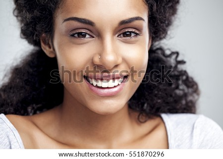 Portrait of a smiling young African woman. - Shutterstock ID 551870296