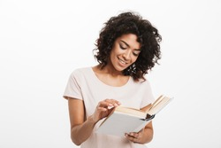 Portrait of a smiling young afro american woman reading a book isolated over white background
