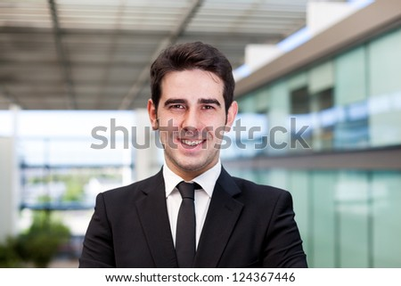 Portrait of a smiling young business man at modern office