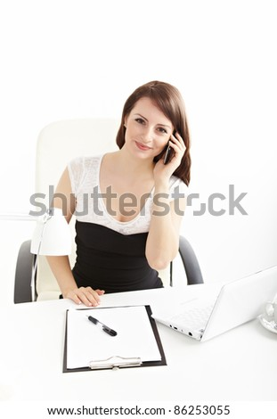 Portrait of a smiling young business woman speaking on mobile phone