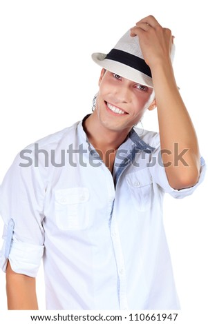 Portrait of a smiling young man in elegant hat. Isolated over white background.