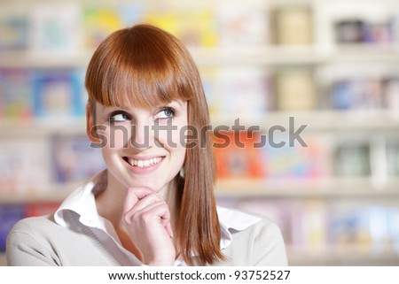 portrait of a  smiling young woman in a library