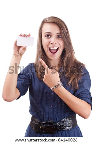 Portrait of a smiling young woman pointing at blank card in her hand against white background