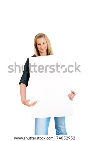 Portrait of a smiling young woman presenting blank bill board over white wall