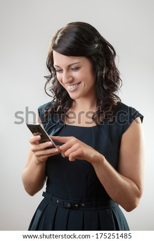 Portrait of a smiling young woman text messaging